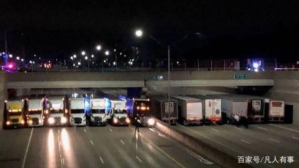 男子立交桥上欲轻生13辆卡车在桥下排成一排