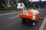 海南:公路管理局引�M�C器人�y公路病害
