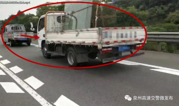 罚200记3分货车故障用软绳拖车11公里